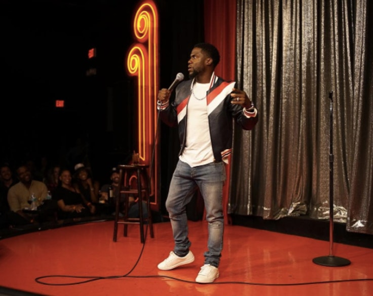Kevin Hart, who will perform at Colossal Clusterfest this month, takes the stage for an event.