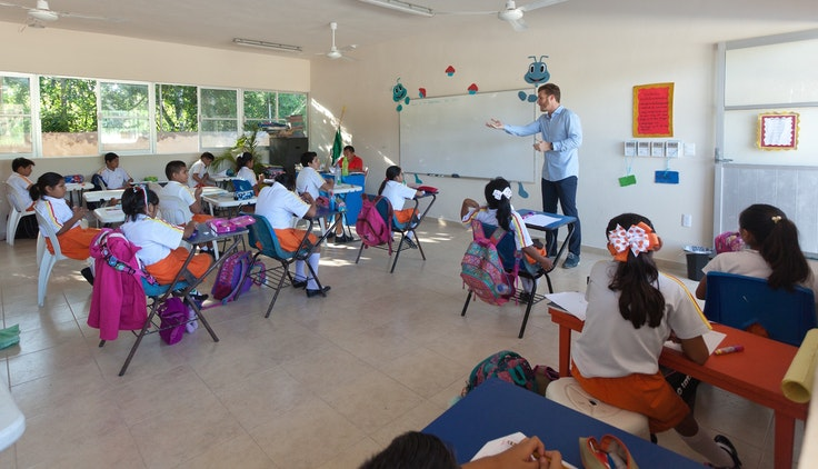 Rosewood Mayakoba General Manager, Daniel Scott, visiting kids in the school he helped build.