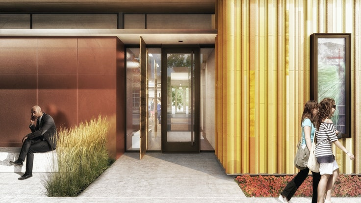 The facade of theKirkland Museum'snew building glows with yellow terra cotta barsand gold-backed glass rods.