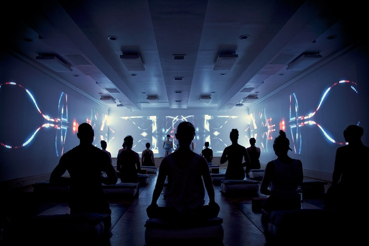 Take a group class that combines yoga and audio at WOOM Center.