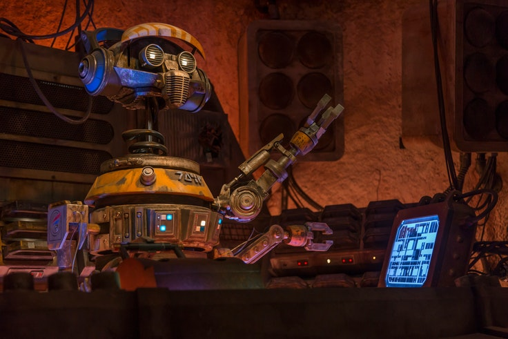 """Fear not: The """"Cantina Theme"""" from """"Star Wars: A New Hope"""" is not on an endless loop at Oga's Cantina. Instead, the droid DJ R3X plays the latest in galactic techno pop while grooving to his own tunes."""