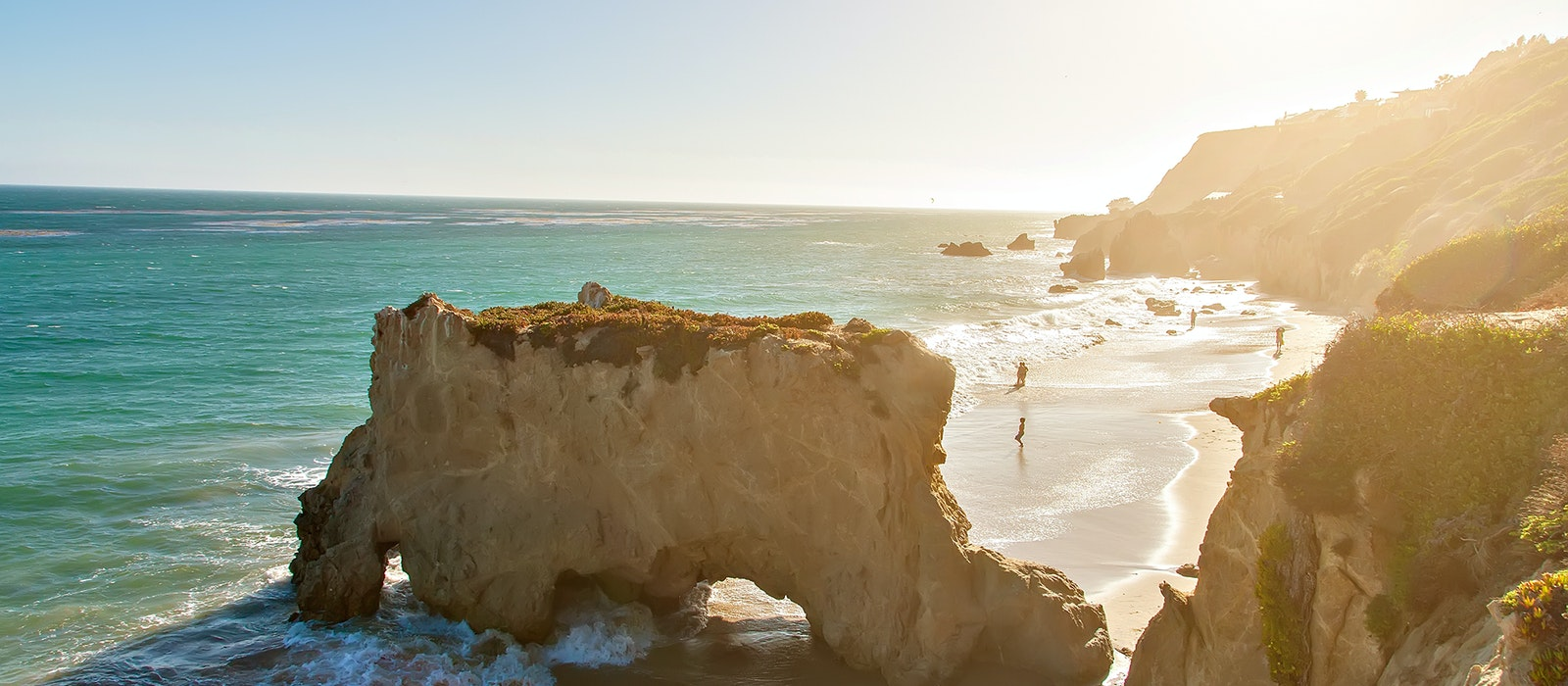 During low tide at El Matador State Beach, you'll be able to walk through the rocky arches.