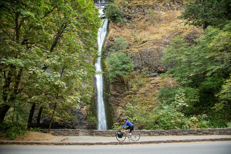 One of the best ways to experience the Columbia River Gorge? By bike, which allows you to cruise by such sights as the 176-foot Horsetail Falls.
