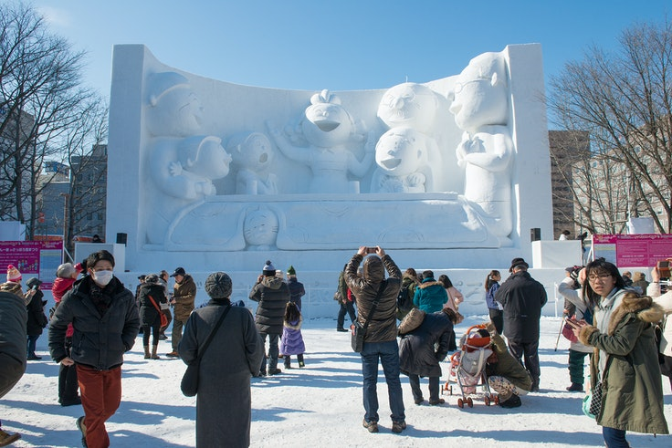 Japan's Sapporo Snow Festival features huge snow and ice sculptures, snow tubing, and the crowning of an Ice Queen.