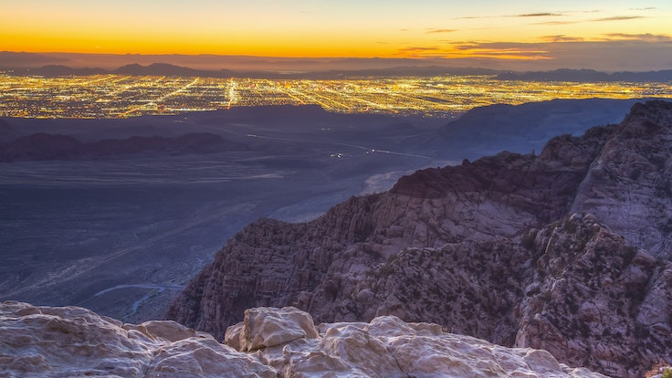 Climbing in Red Rock Canyon will give you a whole new view of the lights of Vegas.