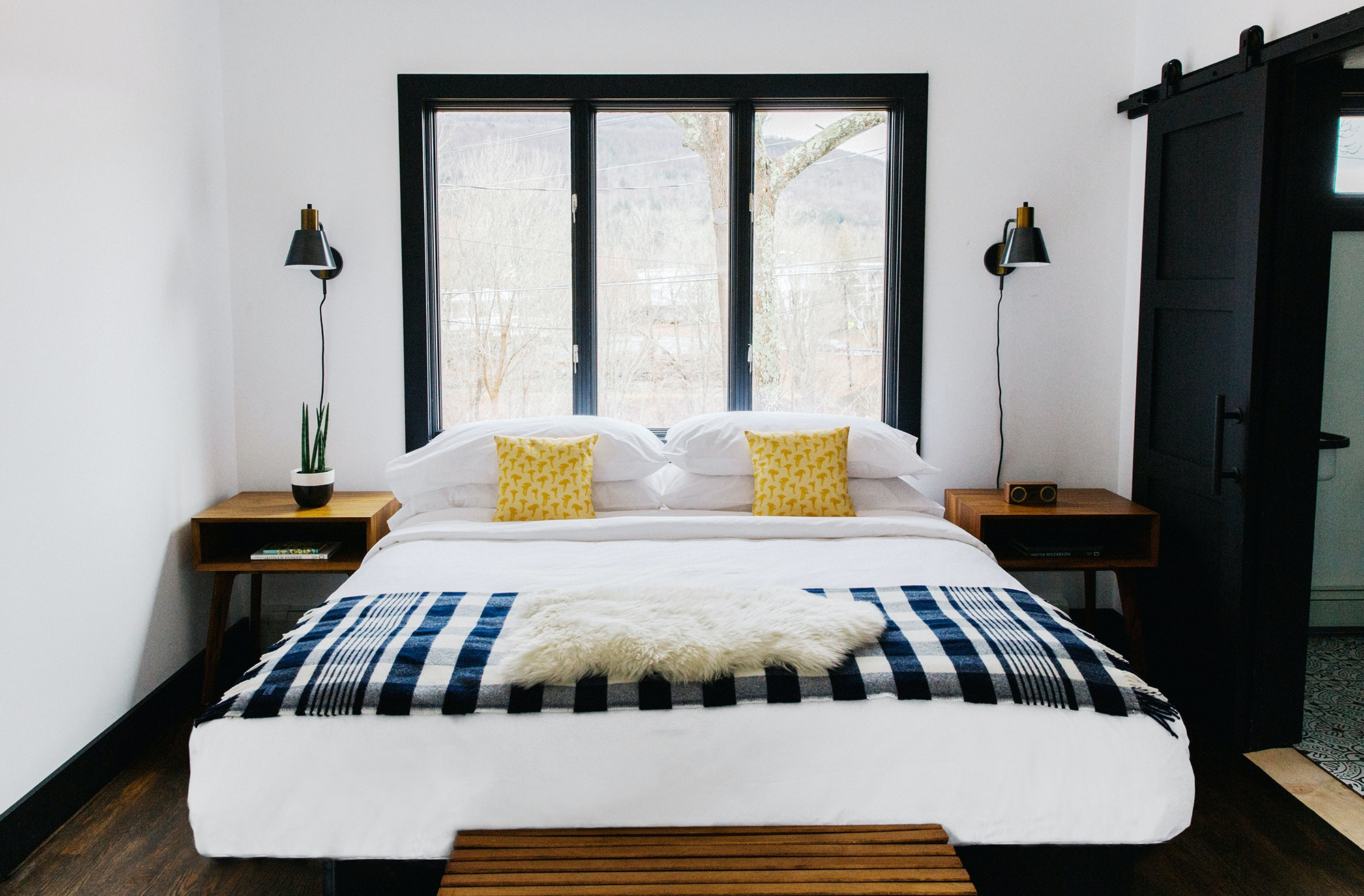 Guest rooms in Eastwind's former-bunkhouse main building are decorated with Scandinavian flair.