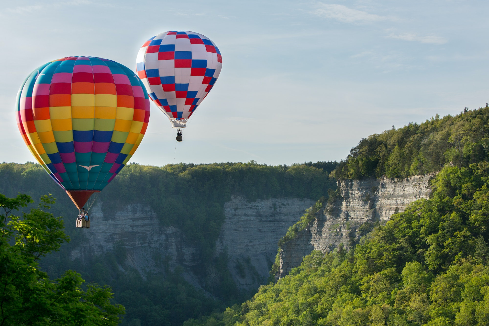 """During the """"Red, White & Blue Balloon Rally"""" every May, onlookers watch as balloons float above Letchworth State Park."""