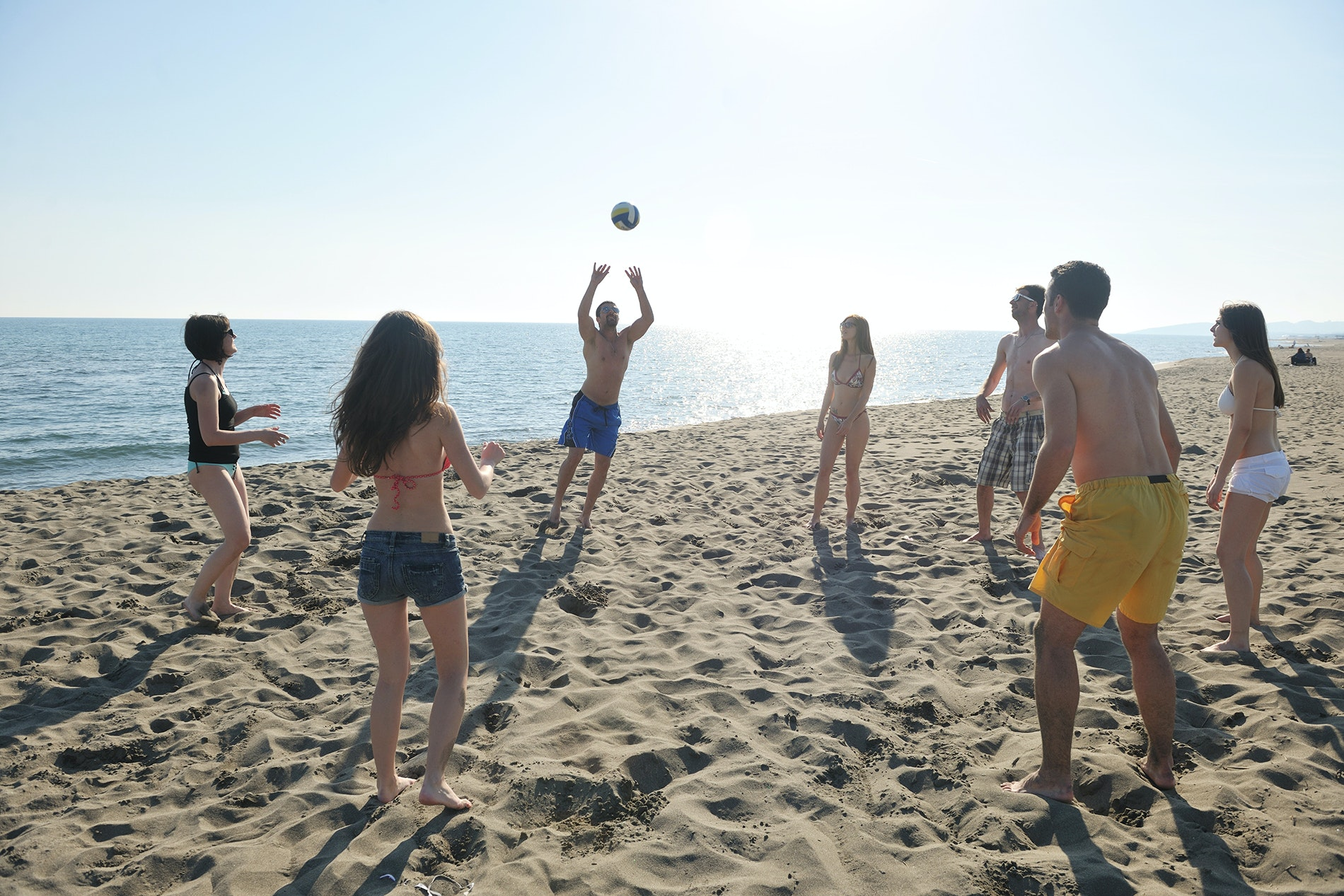Volleyball is a classic beach-day activity for groups.