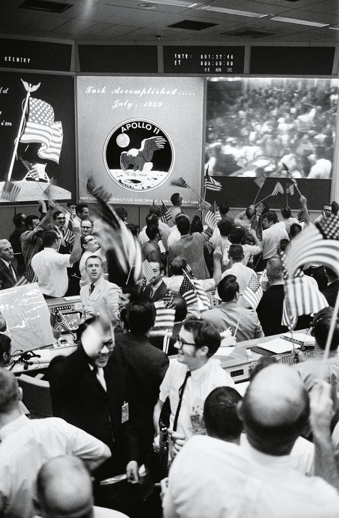 """Celebrations erupt in the Mission Operations Control Room at NASA after """"Apollo 11""""'s successful landing."""