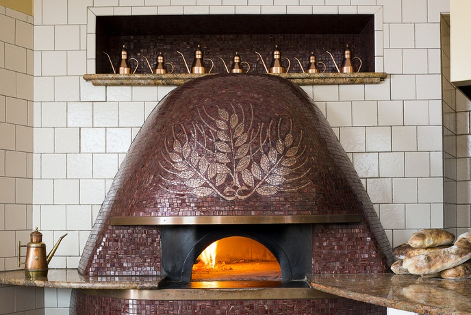 Naples-style pizzas at Spacca Napoli are baked in an oven that was built locally by fourth-generation artisans of Neapolitan descent.