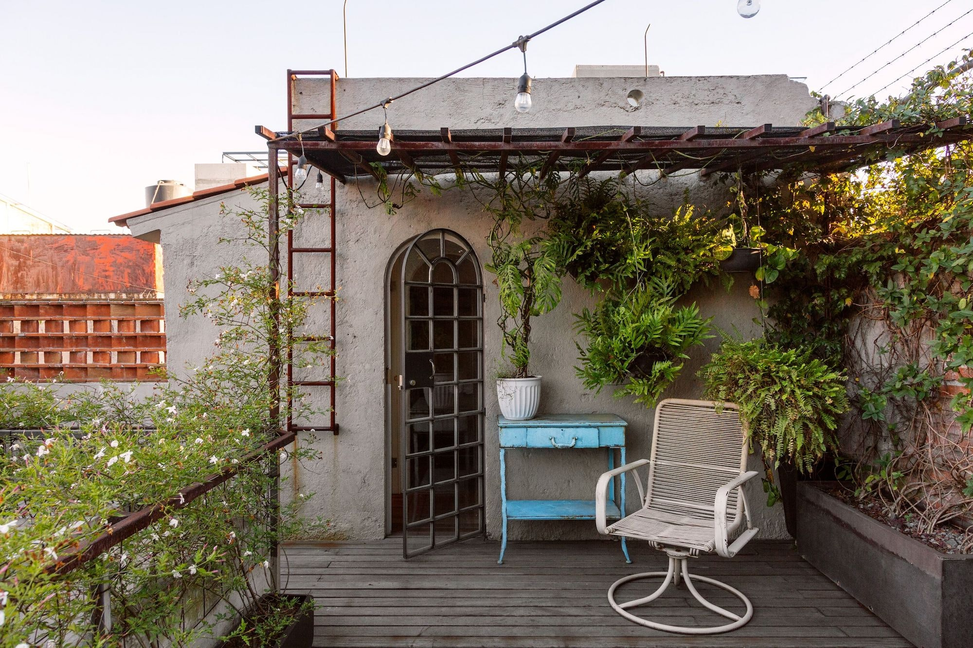 This three-level art deco Airbnb Plus property in Roma Norte includes an outdoor shower and a rooftop terrace.