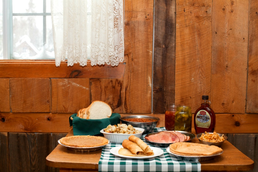 Try a traditional Québécois lunch or dinner—with maple syrup galore—at the Cabane à Sucre L'En-Tailleur.