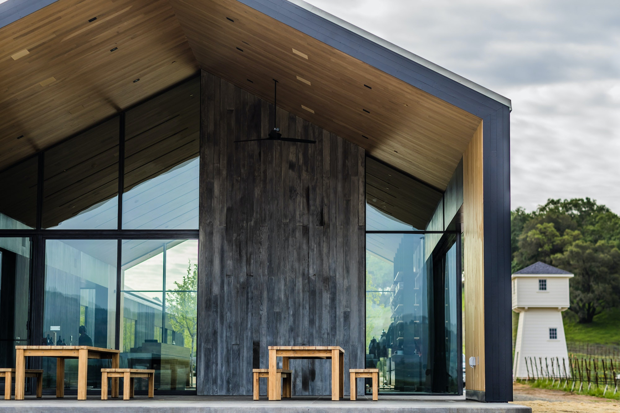 Salvaged materials are the star of the show: The Silver Oak team used felled oak trees for floors and repurposed 1930s-era redwood wine tanks as exterior siding.