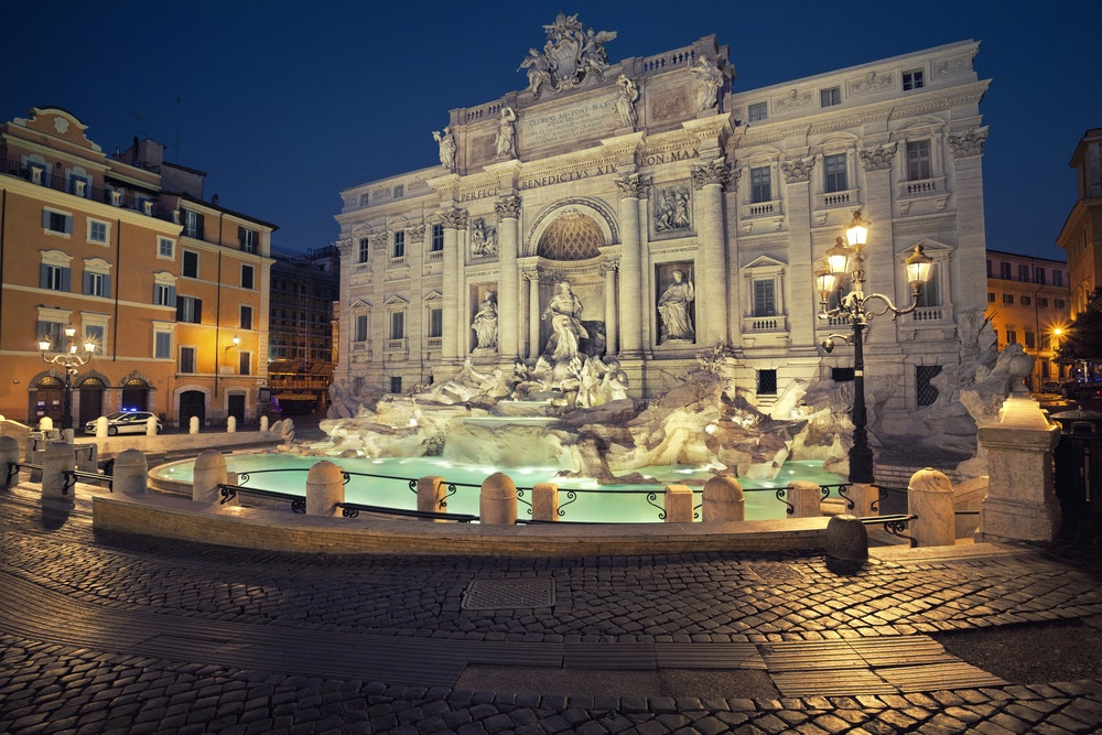 Don't forget to toss a coin (or three) into the Trevi Fountain to wish for a return to Rome.