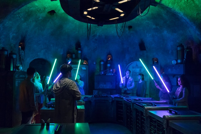 Lightsaber customization at Savi's Workshop includes choosing a handle, a beam color, and a mysterious crystal that holds a personal connection to the creator.