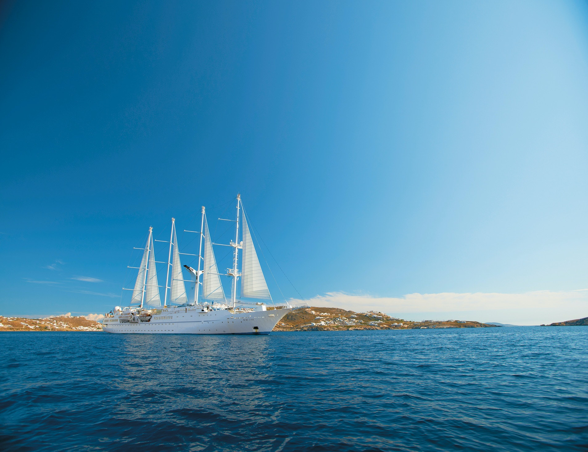 Masted ships and Greek islands are a winning recipe for romance on Windstar Cruises.