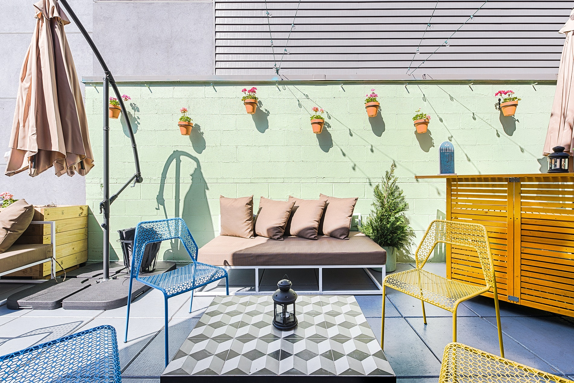 Beachy vibes rule the roof at the Colada Shop.