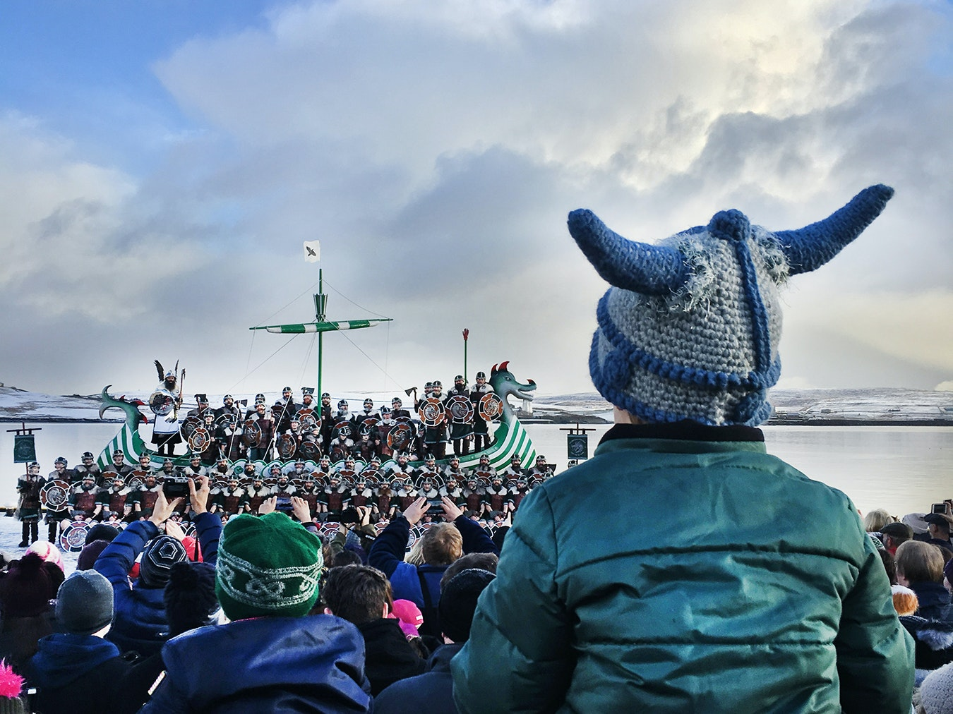 Crowds gather to see the 2019 Jarl Squad pose for photos with their galley ship in Lerwick, Shetland.
