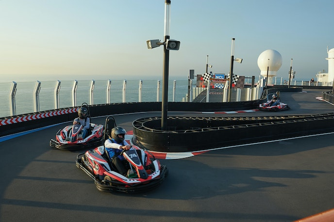 Teens love the high-thrills attractions of Norwegian ships, like go-karting on outdoor race tracks at speeds of up to 30 mph.