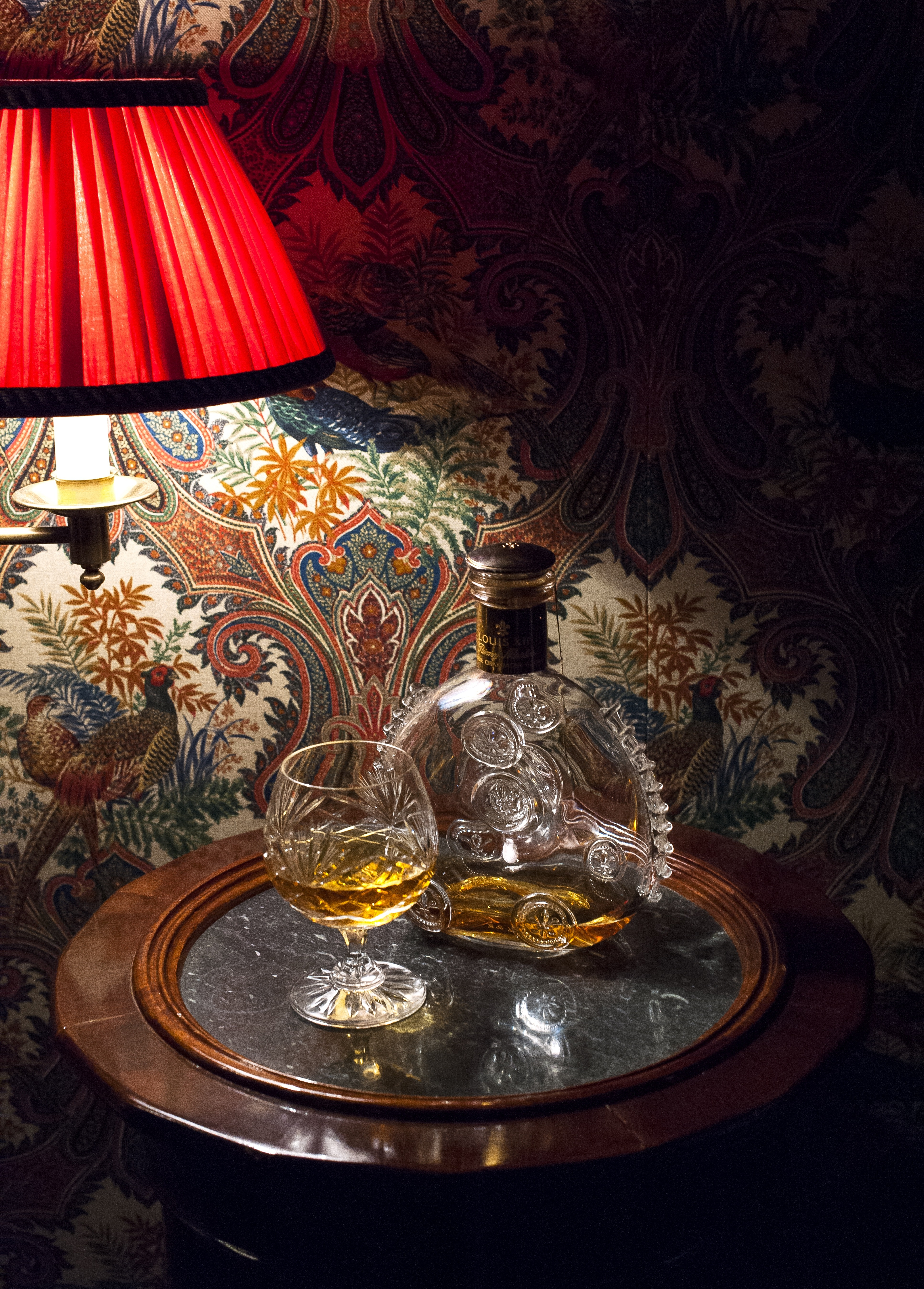 A glass of Remy Martin Louis XIII cognac awaits guests at Ashford Castle, a converted 1200s-era castle that's now a five-star hotel.