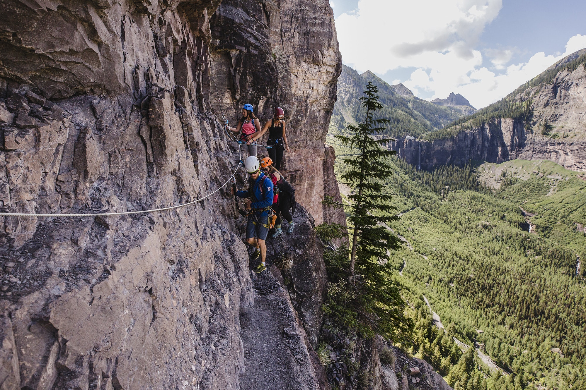 The crux of Telluride's iron way peers over a 300-foot drop to the valley floor.