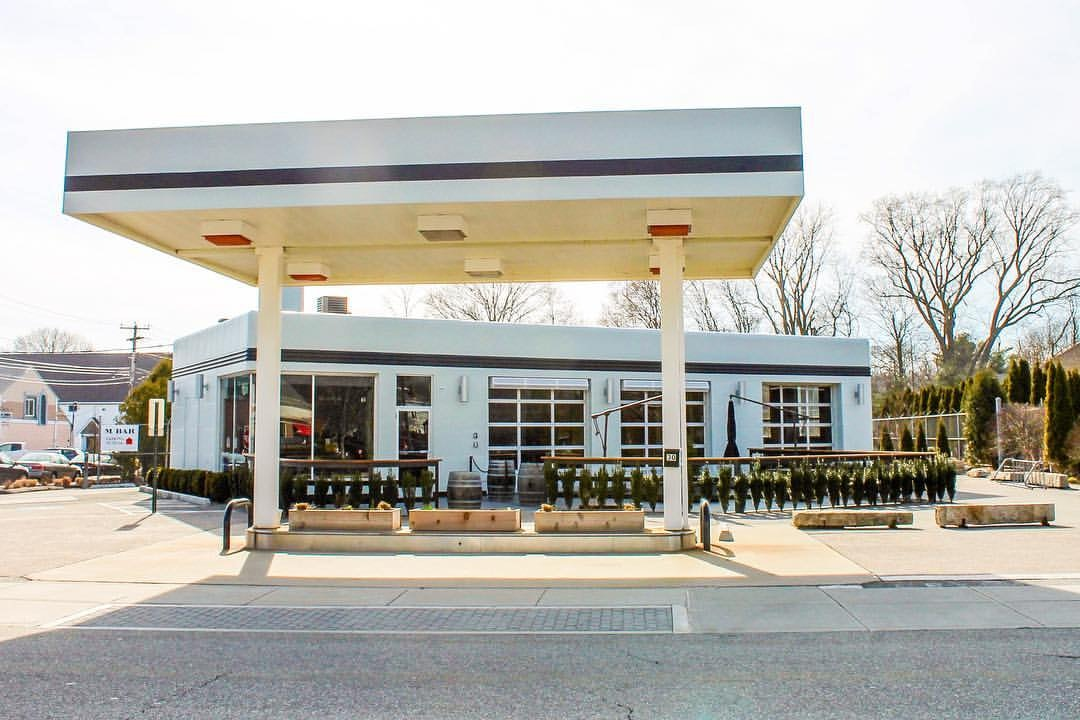 MBAR, in Connecticut, has been converted into a café and restaurant, but still retains its old-fashioned gas station feel.