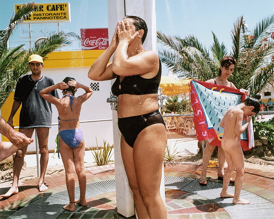 Beachgoers in Italy rinse off before and after their day at the seaside.