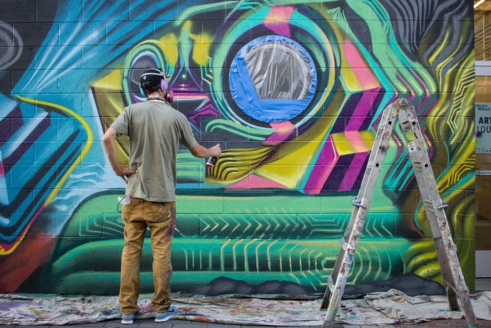 Invited street artist Pharaoh One works on a piece for the 2018 CRUSH Walls in Denver.