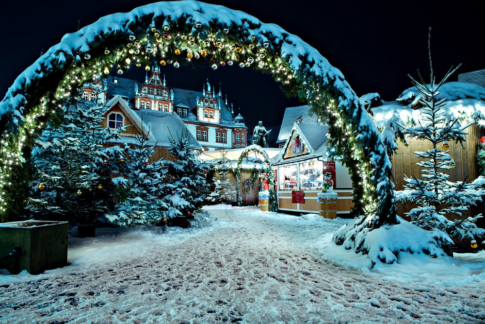 A festive Christmas market by night and under a blanket of snow in Coburg, Germany