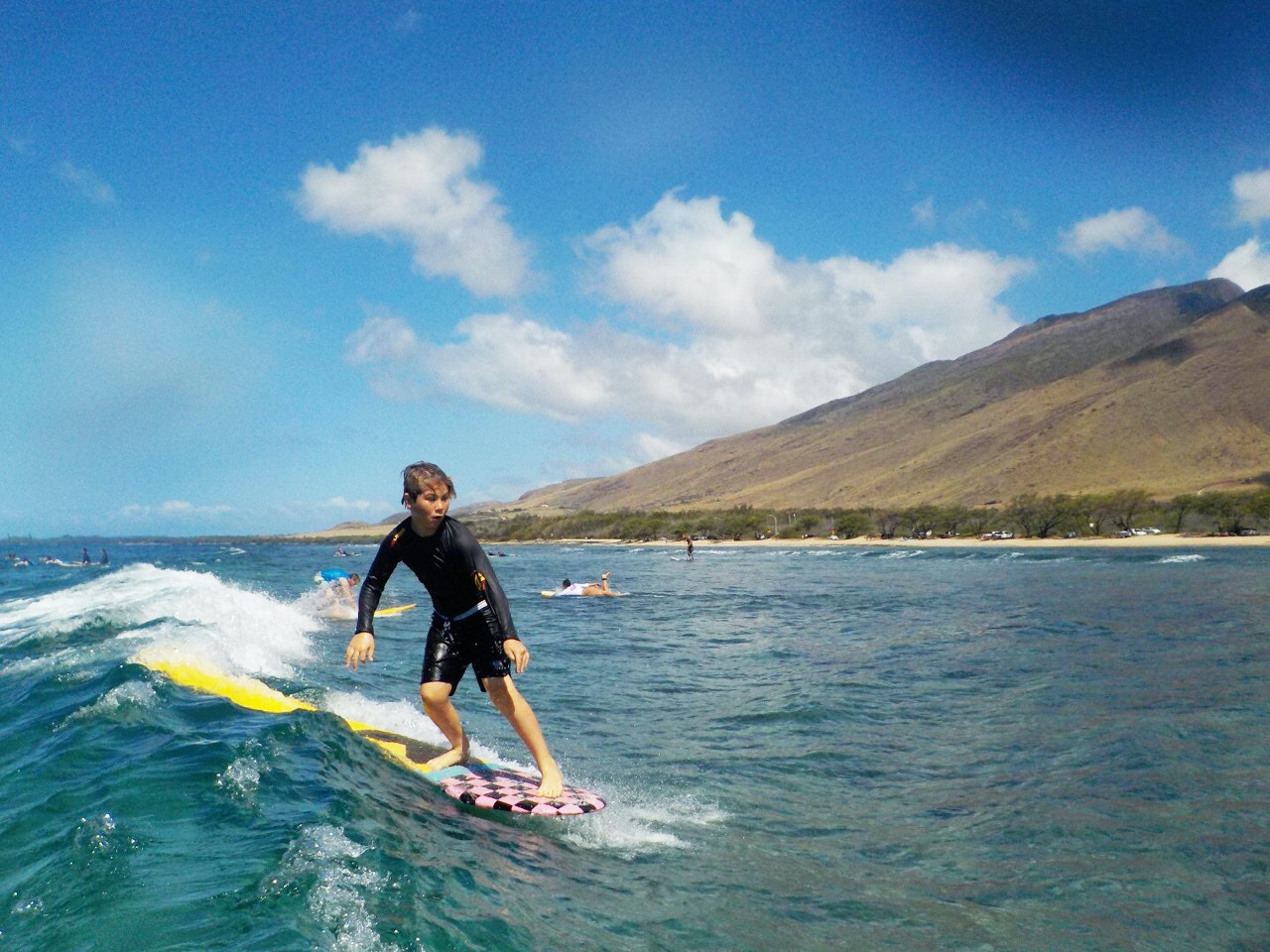 Get surf lessons from pro surfer Zack Howard at his Maui surf school.