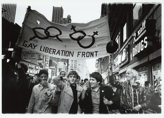 Protestors march at a 1970 NYC Pride Rally. (Image by Diana Davies, one of the leading photojournalists who documented the LGBTQ liberation movement during the '60s and '70s.)