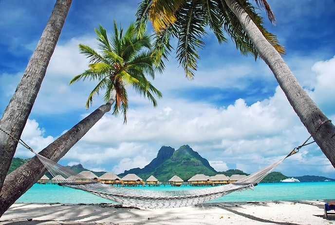 Snorkel in the clear waters or relax on a pristine beach in Tahiti, voted the top water sports destination by AFAR readers.
