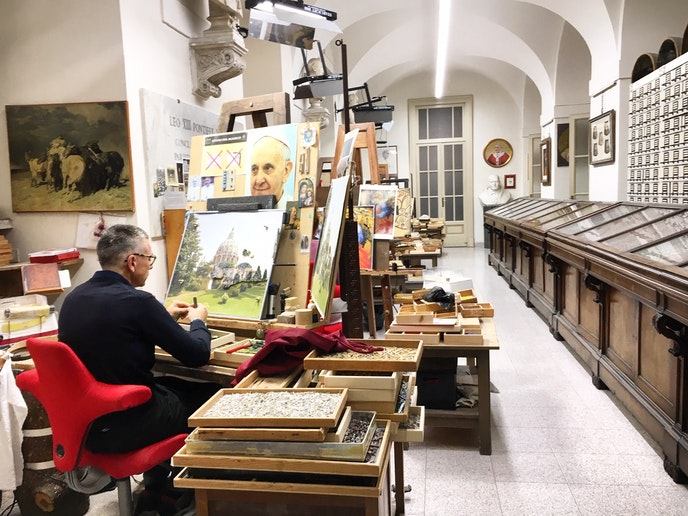 An artist works in the quiet Vatican Mosaic Studio. Mosaics can cost up to $230,000.