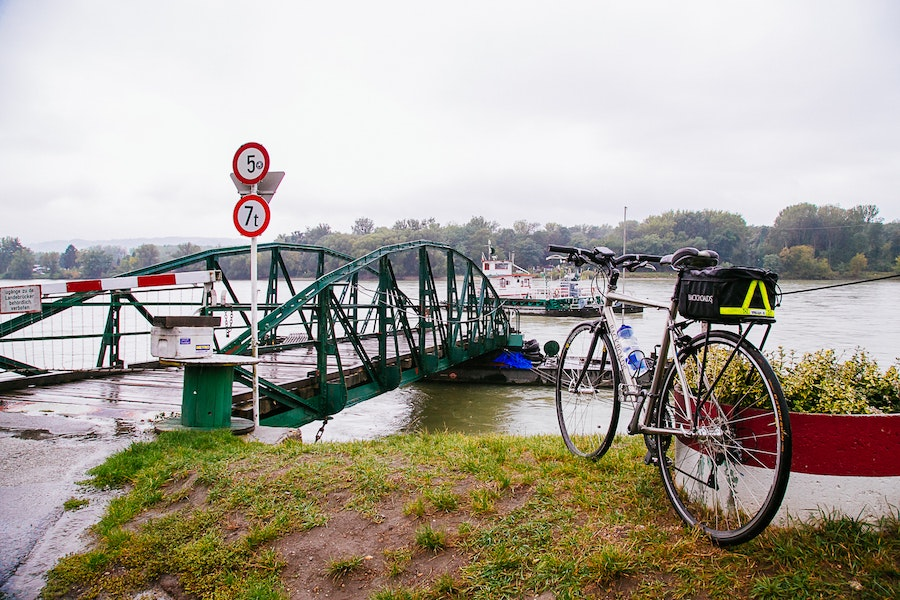 Small barges ferry cyclists, walkers, and even cars across the Danube in Austria.