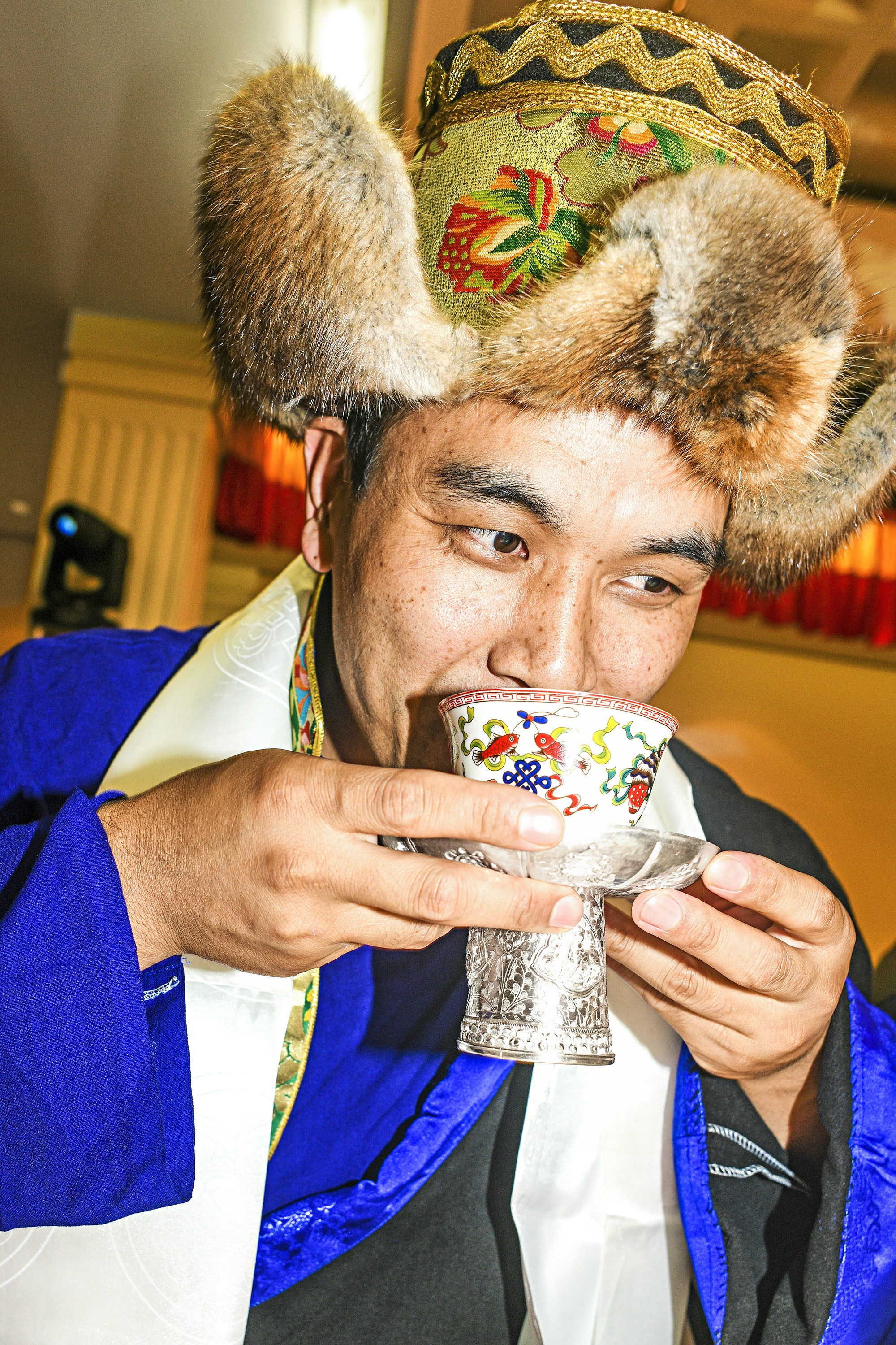 A cup of butter tea is part of wedding festivities at the United Sherpa Association.