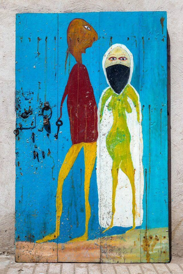 One of Ben Ali's colorful pieces, painted on a door.