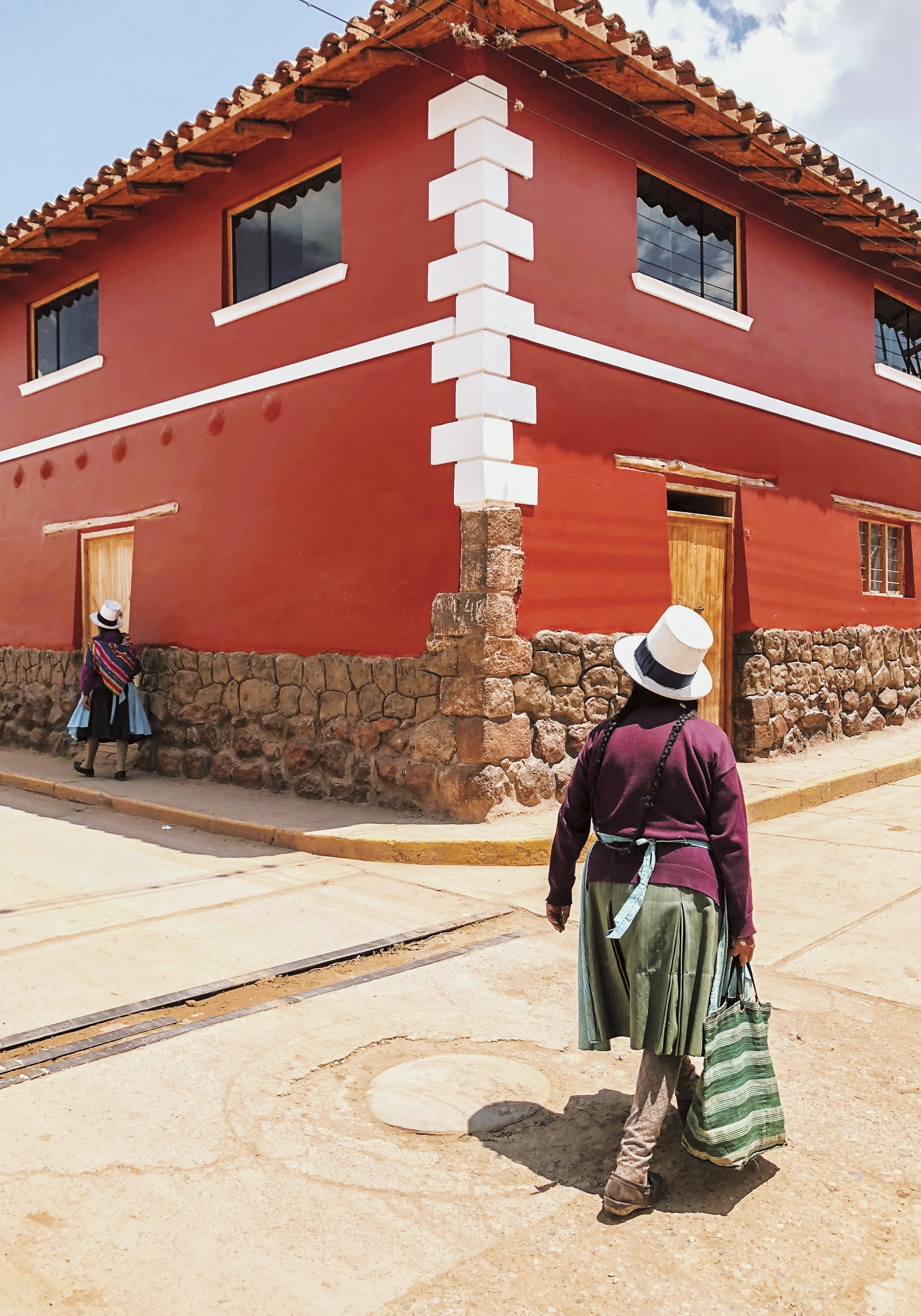 Locals walk in the town of Maras.