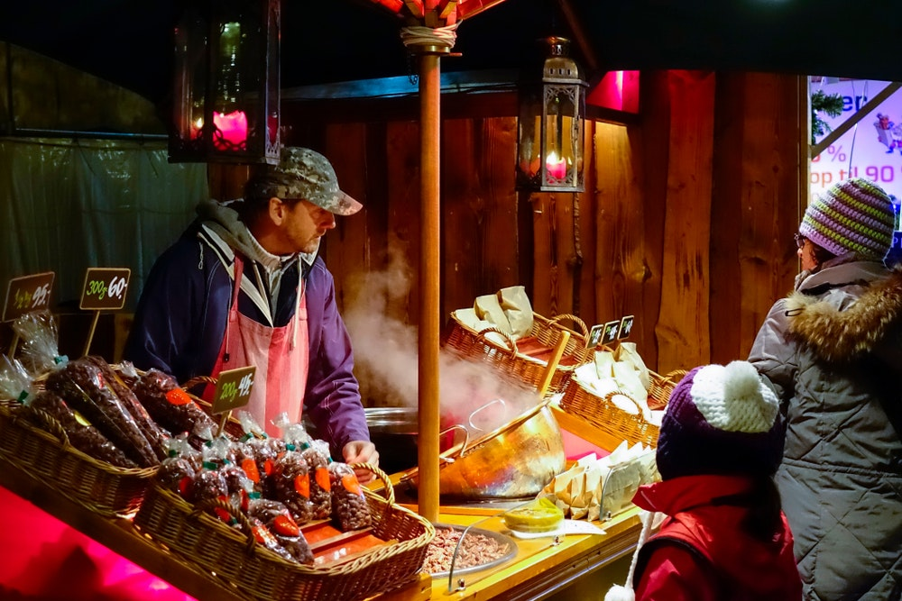 Vendors sell an array of goodies to snack on and stay warm during chilly December nights.