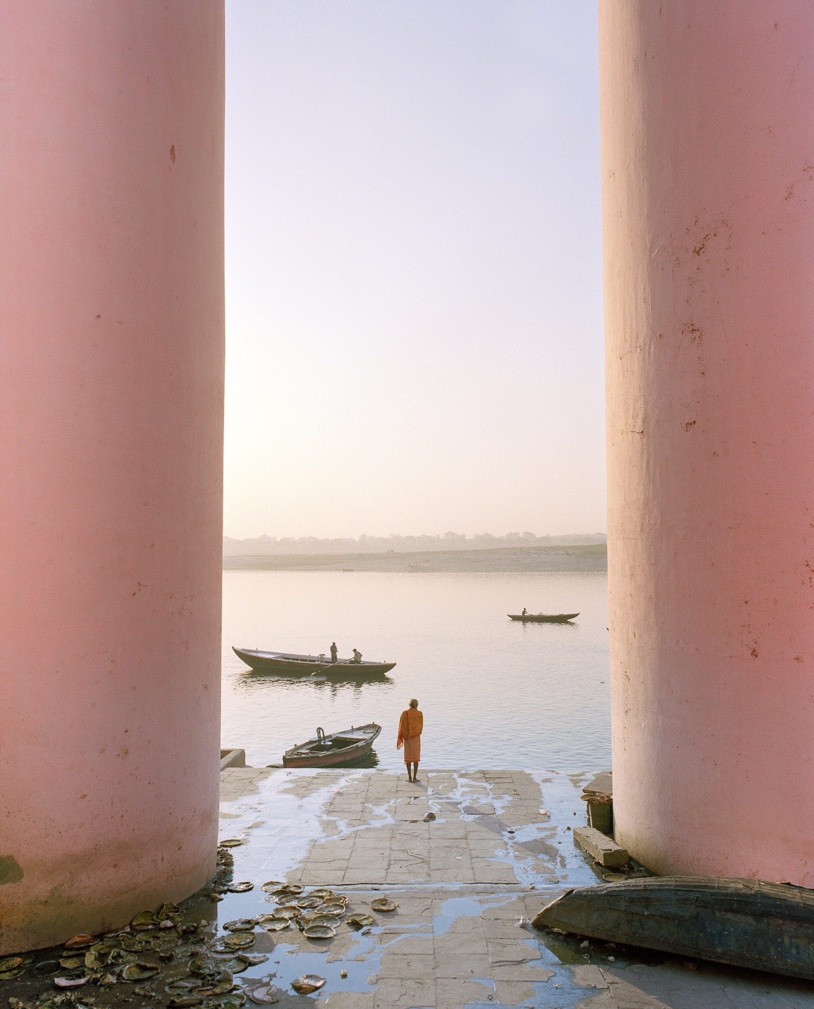 A monk greets the dawn on the Ganges River in Varanasi.
