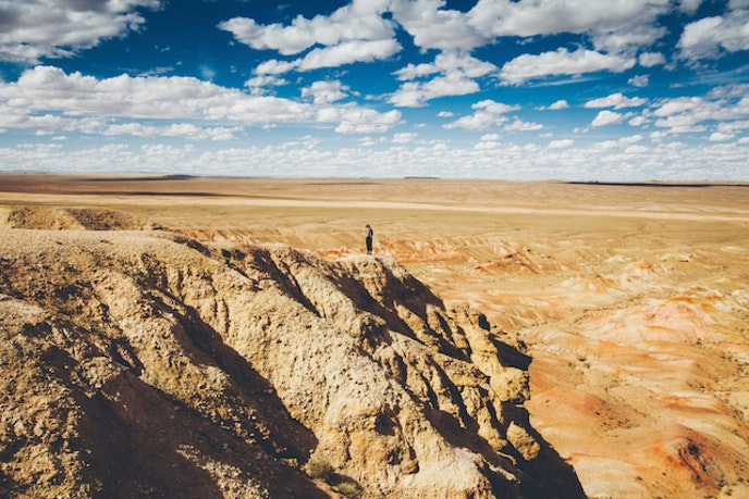 Jamadi uses a person to show the vastness and scale of Mongolia's Gobi Desert landscape.