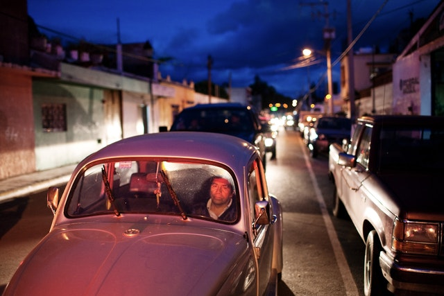 A man sits behind the wheel in traffic during rush hour in Oaxaca City.
