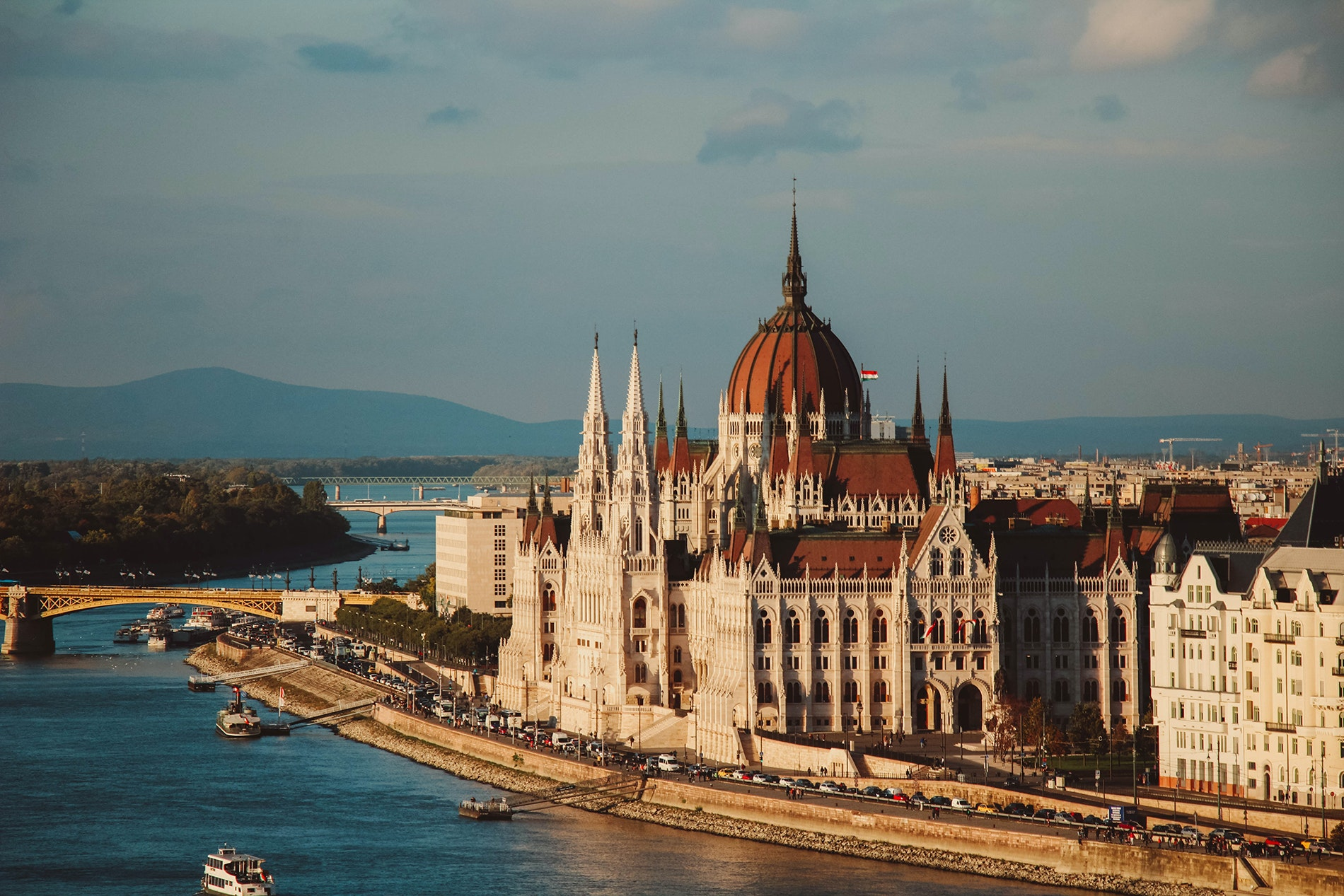 The River Danube bisects Hungary, a chain bridge connecting the hilly, western half of the city called Buda with the flat, eastern part called Pest.