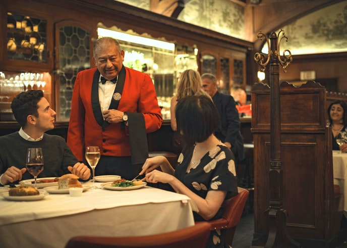 Many of Musso's waiters have been there for decades and are known for sporting bright red tuxedo jackets and impeccable manners.