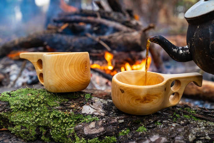 Drinking coffee might not make you happy, but sharing it with friends outdoors, as Finns do, could help.