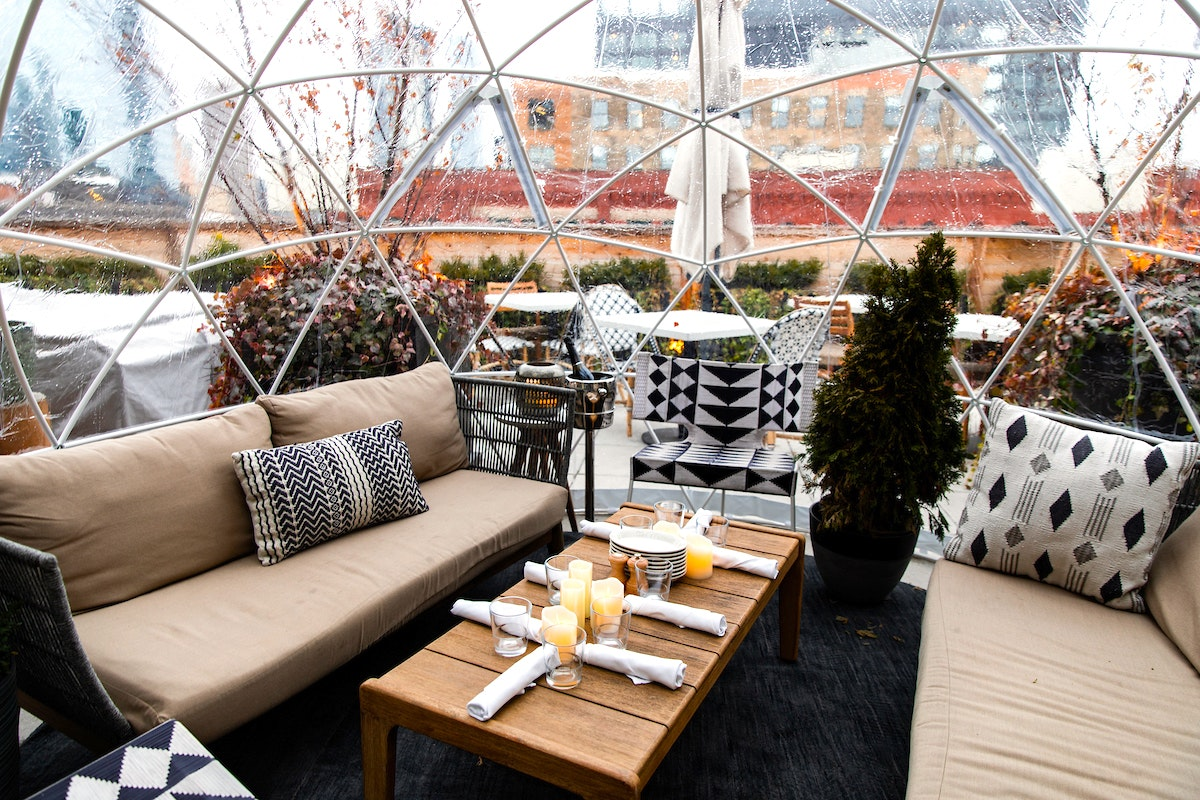 "Glass-enclosed domes or ""igloos"" are a chic solution to all-weather al fresco entertaining."