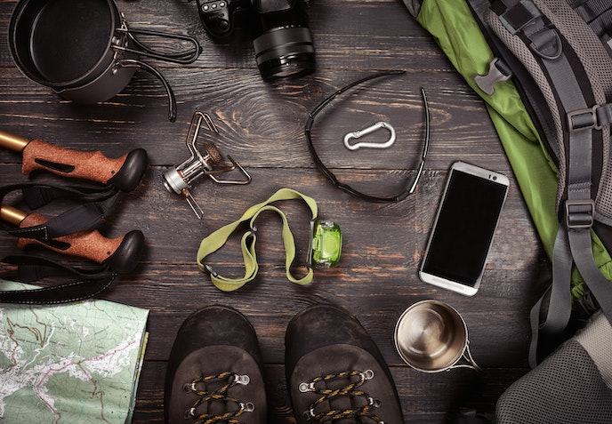 When it comes to camping gear, smaller tents can come on flights as carry-on, but tent poles have to be checked, along with walking sticks.