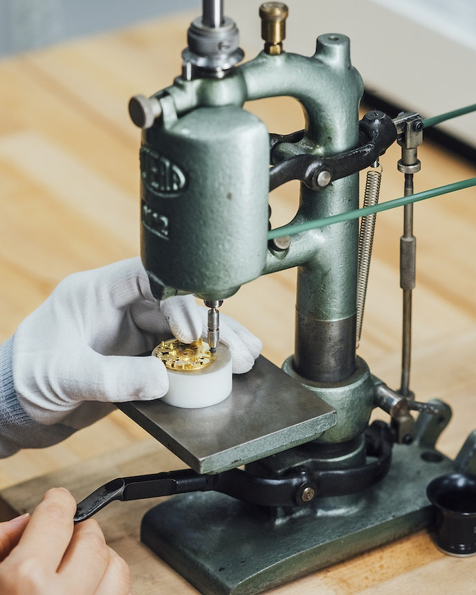 After passing through initial computerized construction, the watch-assembling process turns manual, where workers set stones and pins, engrave, and oil components of the piece.