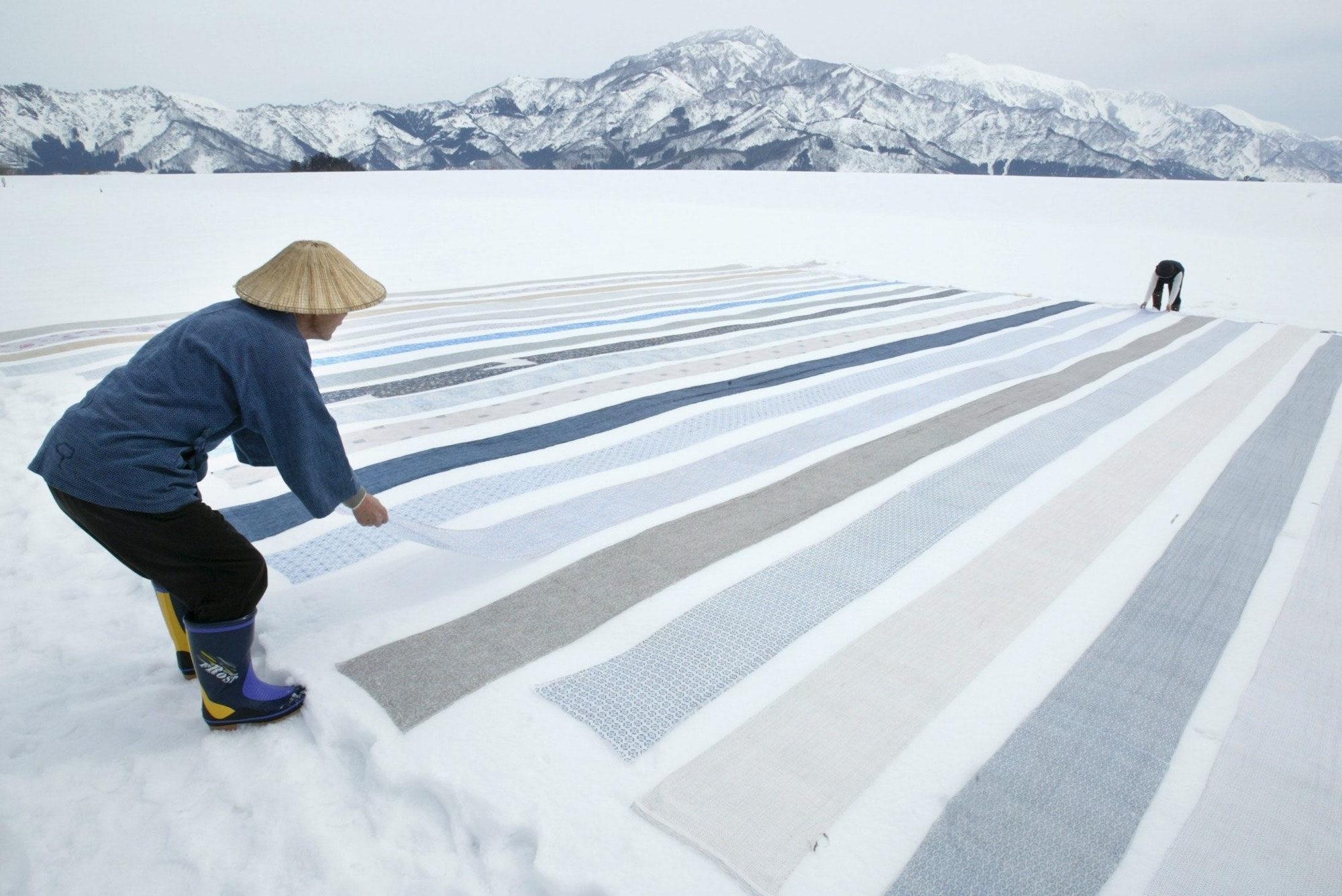 "Japan's Shiozawa village is famous for the ""Yuki-zarashi"" fabric-making process. Here, a kimono weaver places silk and hemp fabric above the snow to remove impurities."
