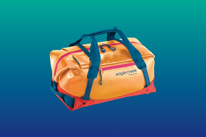 """The Migrate Duffel 40L comes in """"Sahara Yellow"""" (pictured above), """"Arctic Blue,"""" """"Coral Sunset,"""" and """"Jet Black."""""""