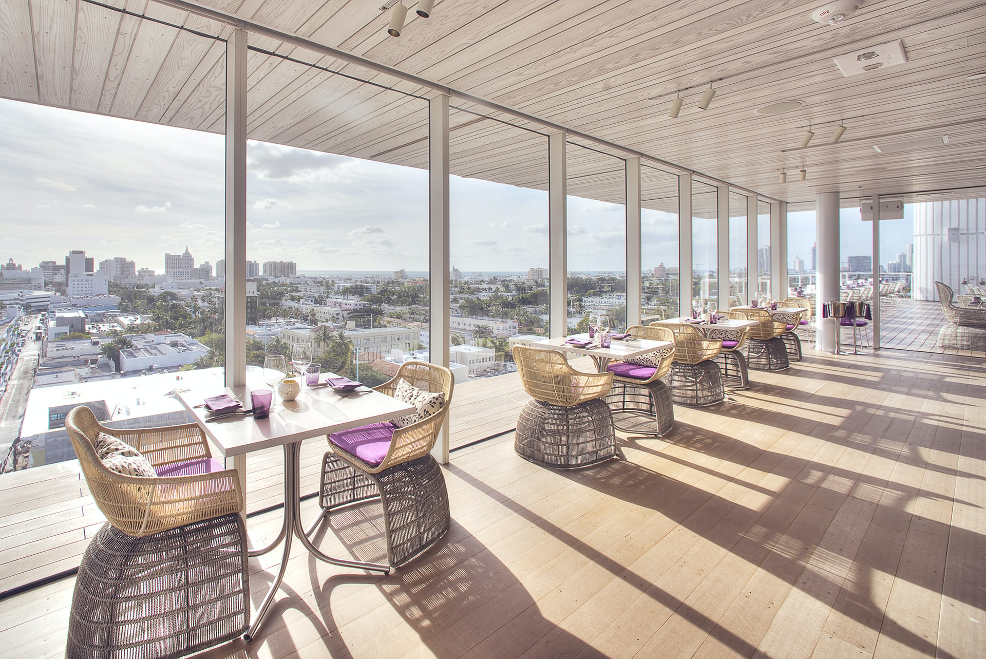 Indoor-outdoor restaurant Juvia boasts panoramic views of the ocean and downtown skyline.